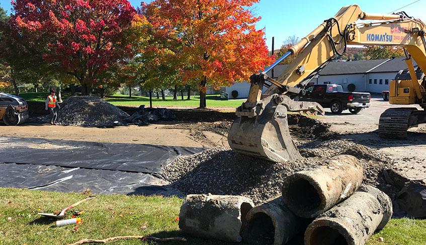 Excavation et pose membrane tissée stationnement